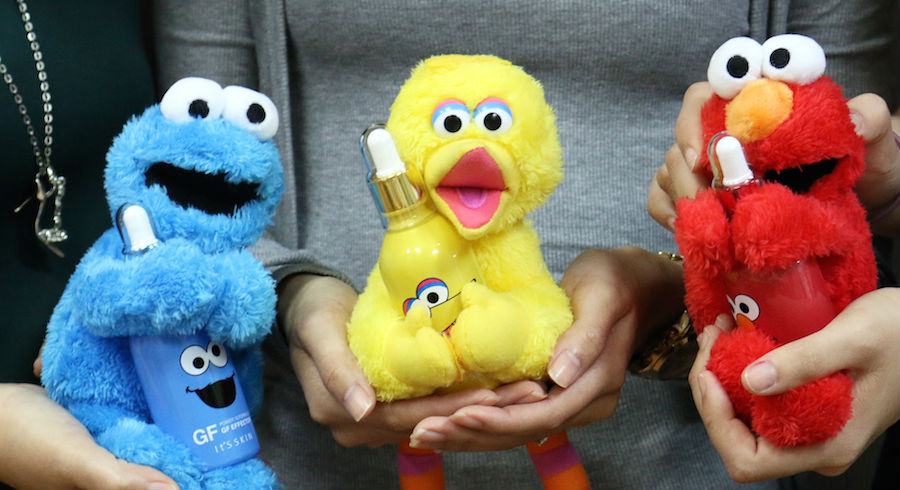 "Cookie Monster, Big Bird & Elmo holding ""milk bottles""? This has to be the cutest collaboration we've seen all year!"