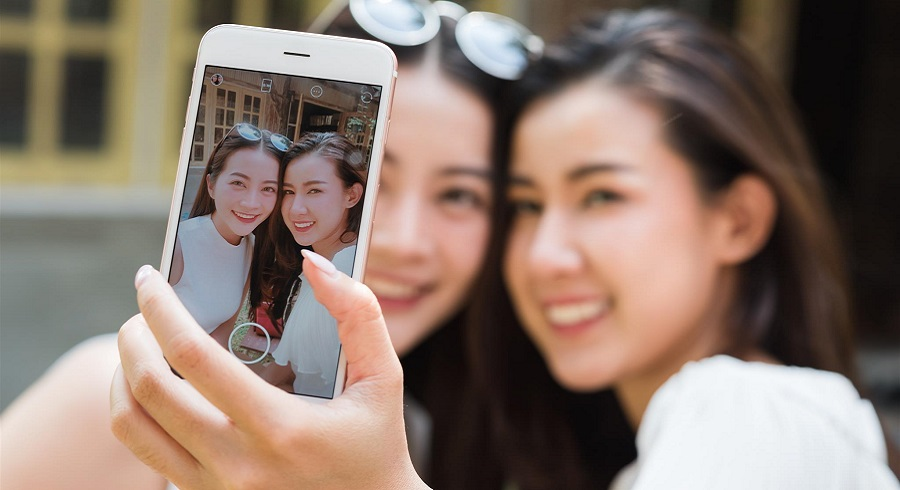 Two asian taking selfie smartphone