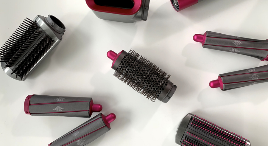 The $699 Dyson Airwrap styler curls, waves, smooths, and dries hair by vacuuming it?!