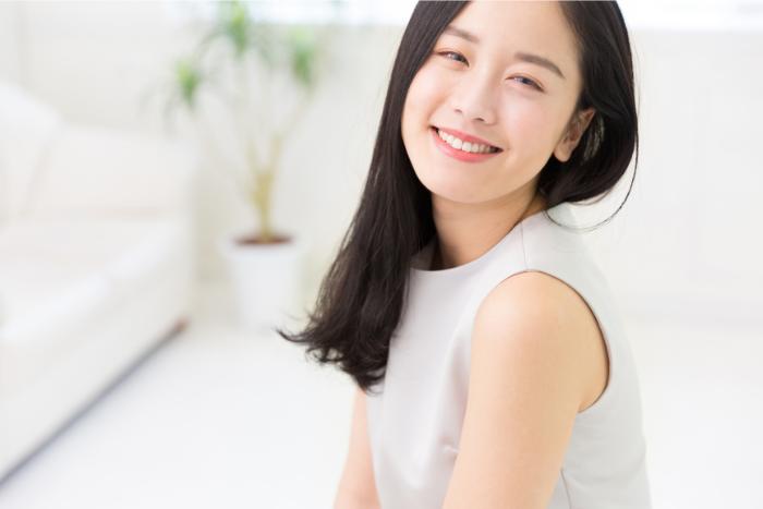 Asian Woman With Beautiful Skin Smiling
