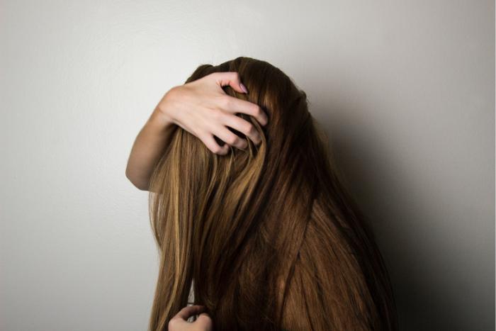 Woman Scratching Scalp Long Hair