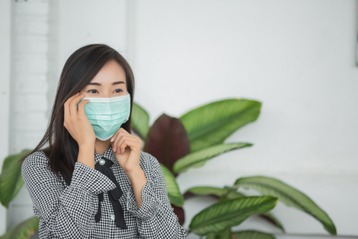 Asian Woman Wearing Surgical Mask Touching Face Source Jcomp Freepik