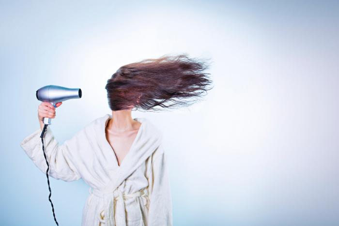 Woman Blow Drying Hair Source Gratisography Pexels