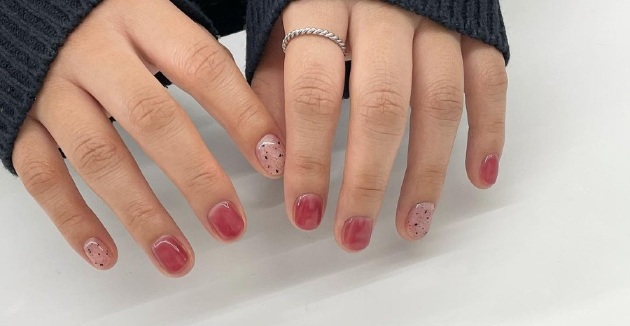 Fig-coloured nails are the way to go if you don't want to paint your nails chilli red