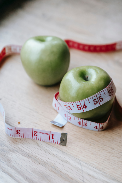 apples with measuring tape source andres ayrton pexels