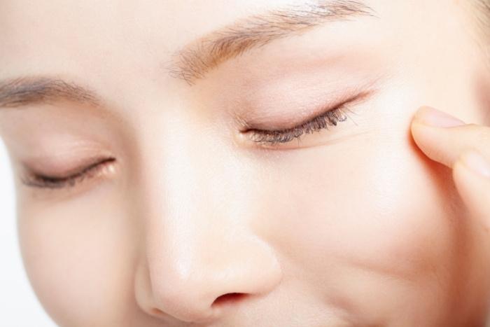 closeup of woman eyes closed