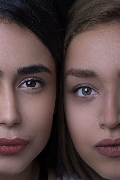 two women with full brows lashes side by side source hadis safari unsplash